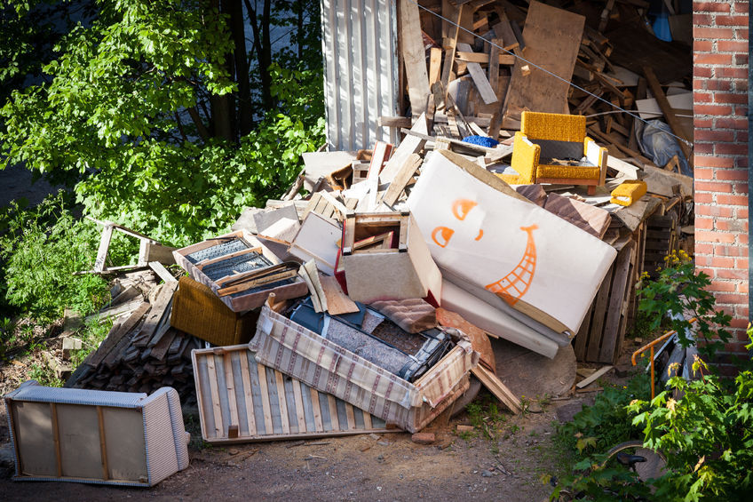 old junk piled up as yard waste
