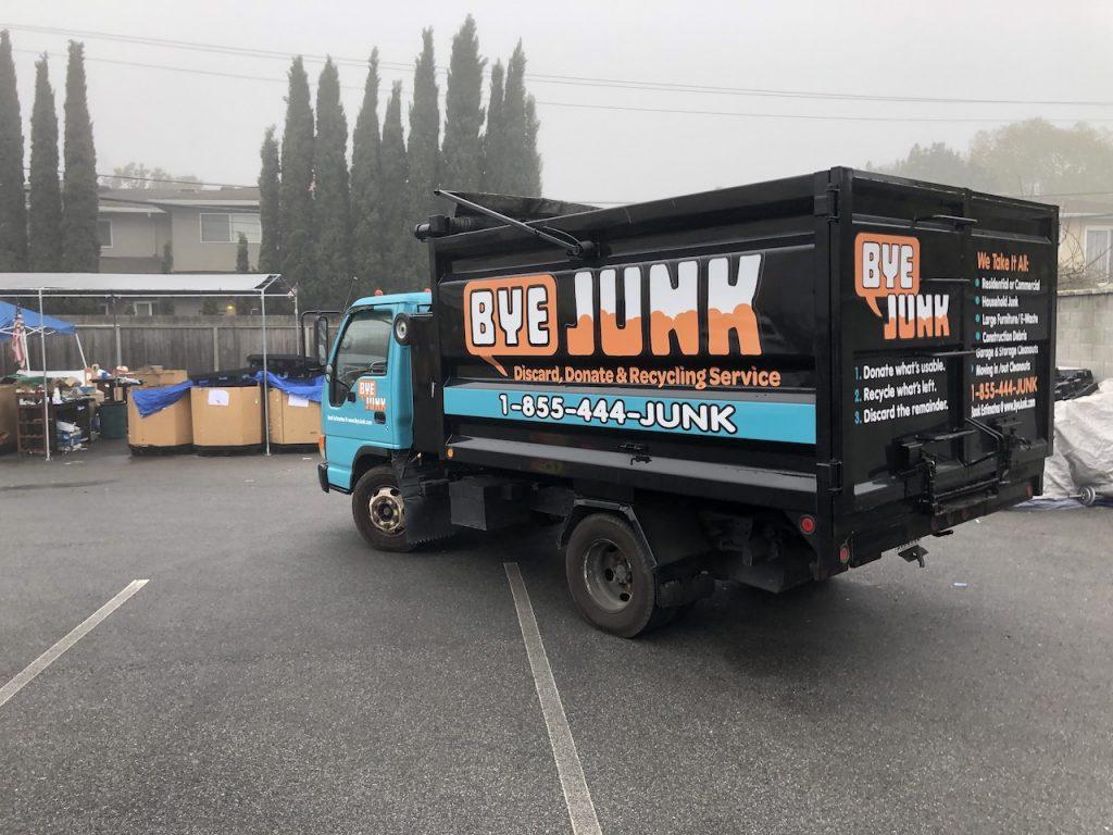 Bye Junk Truck in parking lot for junk removal in dublin ca