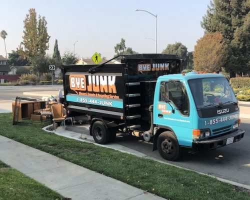 Bye Junk truck picking up unwanted items for junk removal in San Leandro