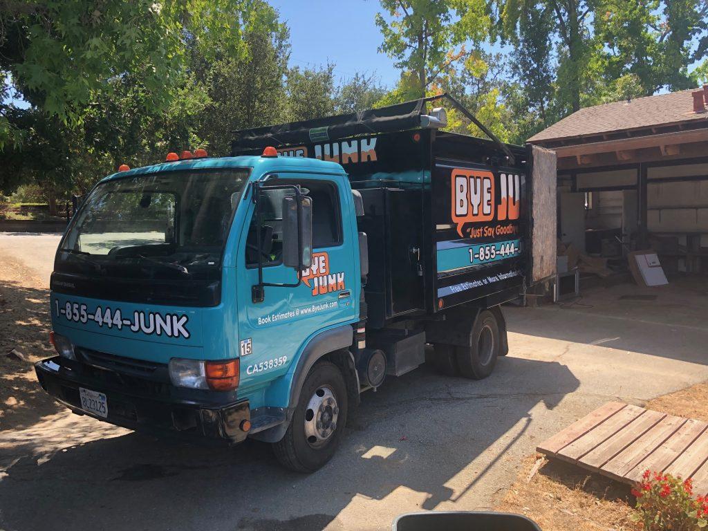 Bye Junk truck offering junk removal in Berkeley