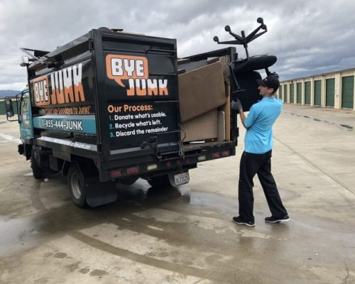 Matt from Bye Junk loading unwanted items during junk removal in newark, CA